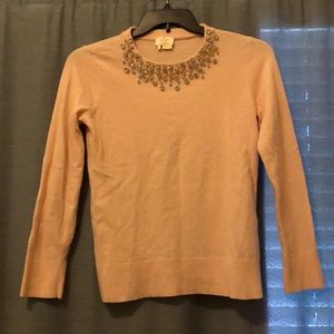 Pink sweater with gemstone detail